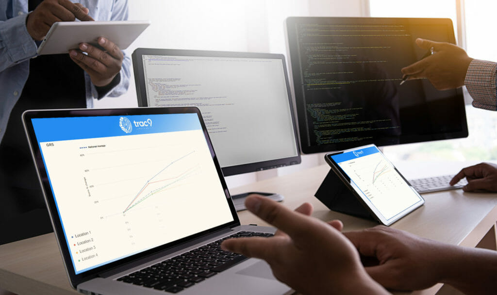 laptop and tablet with trac 9 software on it